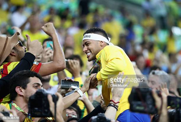 Neymar of Brazil is surrunded by supporters following the Men's Football Final between Brazil and Germany at the Maracana Stadium on Day 15 of the...
