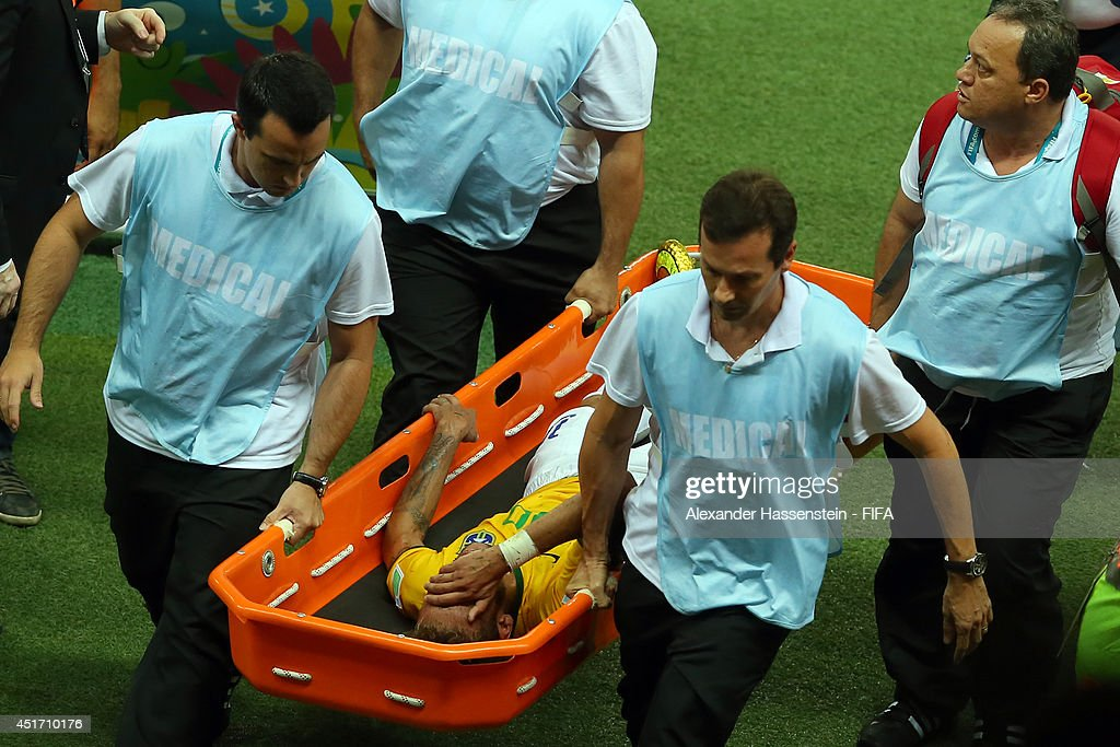Neymar of Brazil is taken off the pitch by a stretcher during the 2014 FIFA World Cup Brazil Quarter Final match between Brazil and Colombia at Estadio Castelao on July 4, 2014 in Fortaleza, Brazil.