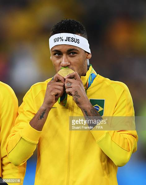 Neymar of Brazil kisses his gold medal at the Olympic Men's Final Football match between Brazil and Germany at Maracana Stadium on August 20 2016 in...