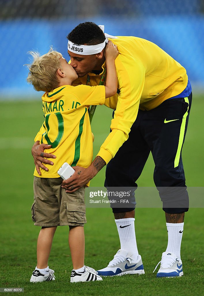 Neymar of Brazil kisses his son at the Olympic Men's Final Football match between Brazil and Germany at Maracana Stadium on August 20, 2016 in Rio de Janeiro, Brazil.