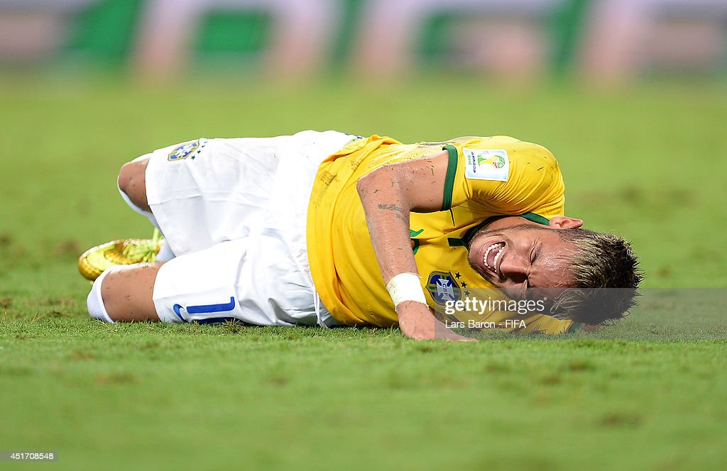 Neymar of Brazil lies injured during the 2014 FIFA World Cup Brazil Quarter Final match between Brazil and Colombia at Estadio Castelao on July 4, 2014 in Fortaleza, Brazil.