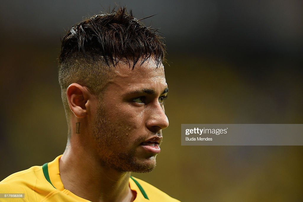 Neymar of Brazil looks on during a match between Brazil and Uruguay as part of 2018 FIFA World Cup Russia Qualifiers at Arena Pernanbuco on March 25, 2016 in Recife, Brazil.