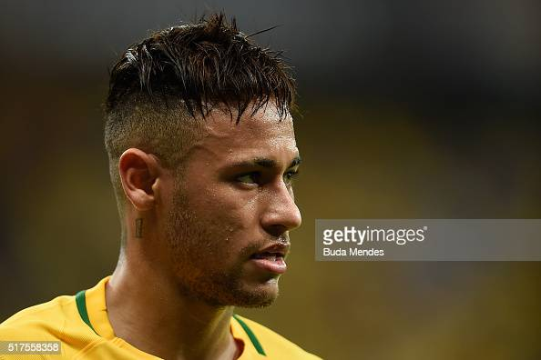 Neymar of Brazil looks on during a match between Brazil and Uruguay as part of 2018 FIFA World Cup Russia Qualifiers at Arena Pernanbuco on March 25...