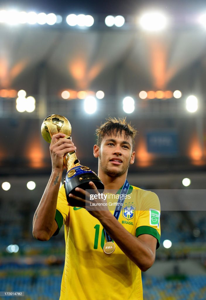 Neymar of Brazil poses with the trophy at the end of the FIFA Confederations Cup Brazil 2013 Final match between Brazil and Spain at Maracana on June 30, 2013 in Rio de Janeiro, Brazil.