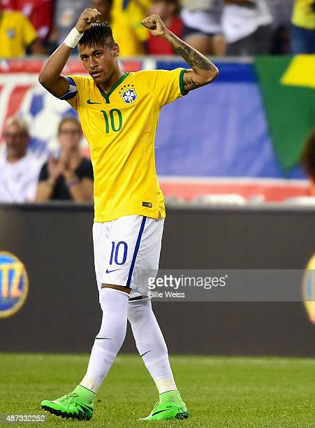 Neymar of Brazil reacts after scoring a goal during an international friendly against the United States at Gillette Stadium on September 8 2015 in...