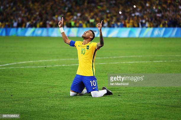 Neymar of Brazil reacts when Brazil win the penalty shoot out during Brazil versus Germany in the Men's football final match at Maracana Stadium on...