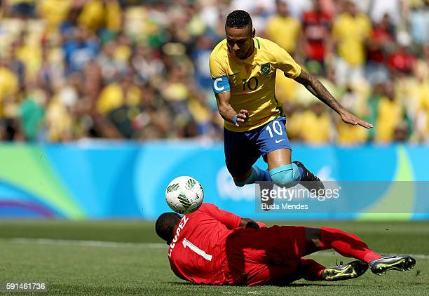 Neymar of Brazil rounds the keeper to score the first Brazil goal during the Men's Semifinal Football match between Brazil and Honduras at Maracana...