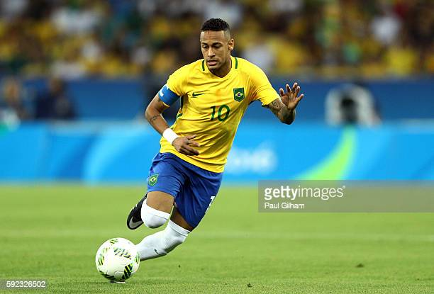 Neymar of Brazil runs with the ball during the Men's Football Final between Brazil and Germany at the Maracana Stadium on Day 15 of the Rio 2016...