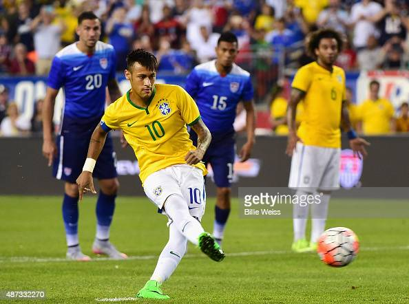 Neymar of Brazil scores a penalty kick goal during an international friendly against the United States at Gillette Stadium on September 8 2015 in...