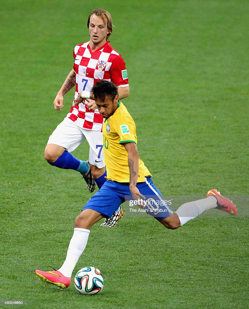 Neymar of Brazil scores his team's first goal during the 2014 FIFA World Cup Brazil Group A match between Brazil and Croatia at Arena de Sao Paulo on June 12, 2014 in Sao Paulo, Brazil.