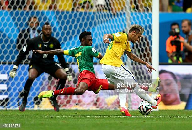 Neymar of Brazil scores his team's second goal during the 2014 FIFA World Cup Brazil Group A match between Cameroon and Brazil at Estadio Nacional on...