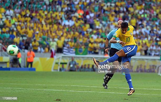 Neymar of Brazil scores the opening goal during the FIFA Confederations Cup Brazil 2013 Group A match between Brazil and Mexico at Castelao on June...