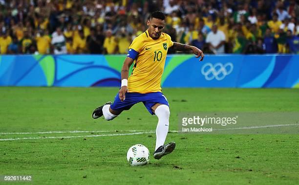 Neymar of Brazil scores the winning penalty during the penalty shoot out during Brazil versus Germany in the Men's football final match at Maracana...