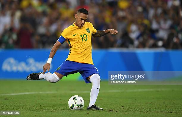 Neymar of Brazil scores the winning penalty in the penalty shoot out during the Men's Football Final between Brazil and Germany at the Maracana...