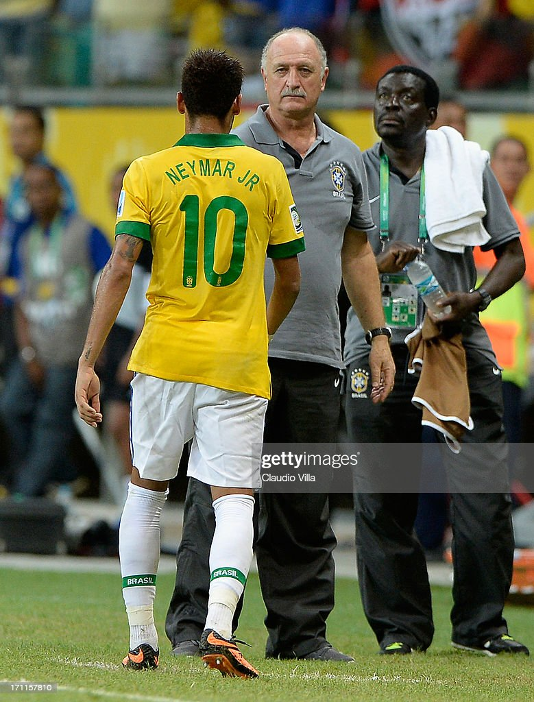 Neymar of Brazil shakes hands with Luiz Felipe Scolari head coach of Brazil as he is substituted during the FIFA Confederations Cup Brazil 2013 Group A match between Italy and Brazil at Estadio Octavio Mangabeira (Arena Fonte Nova Salvador) on June 22, 2013 in Salvador, Brazil.