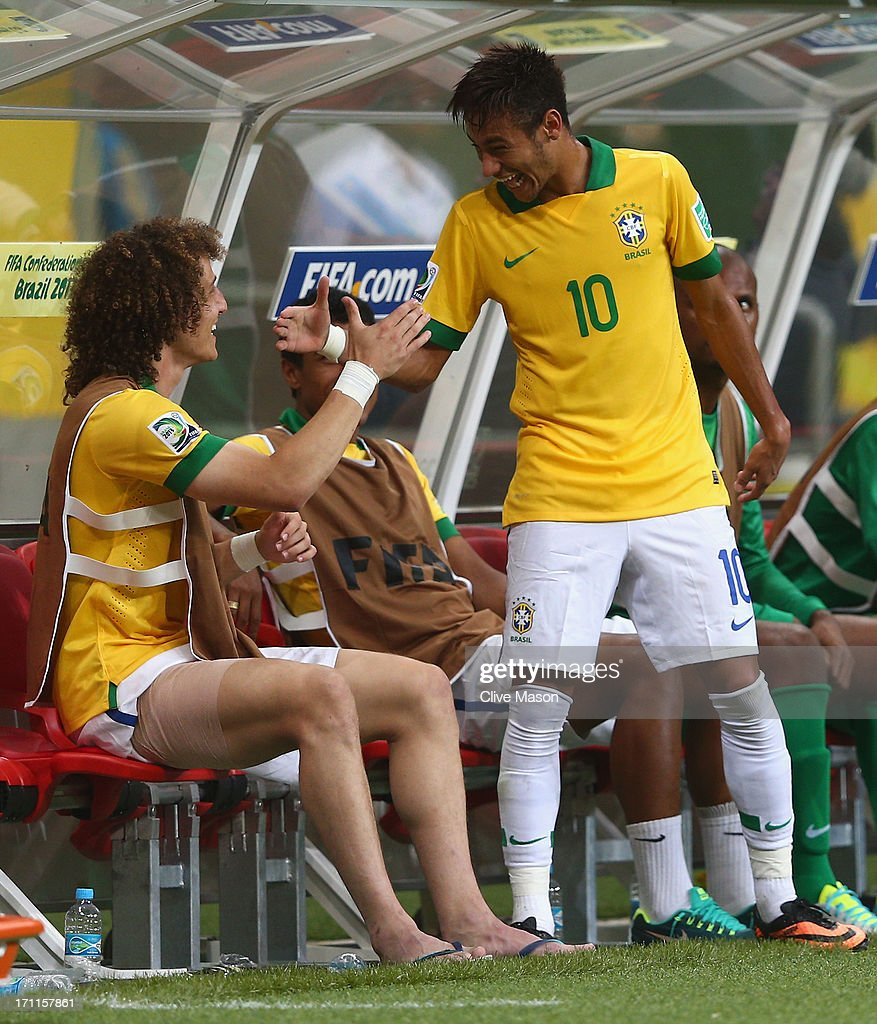 Neymar of Brazil (10) shakes hands with team mate David Luiz as he is substituted during the FIFA Confederations Cup Brazil 2013 Group A match between Italy and Brazil at Estadio Octavio Mangabeira (Arena Fonte Nova Salvador) on June 22, 2013 in Salvador, Brazil.