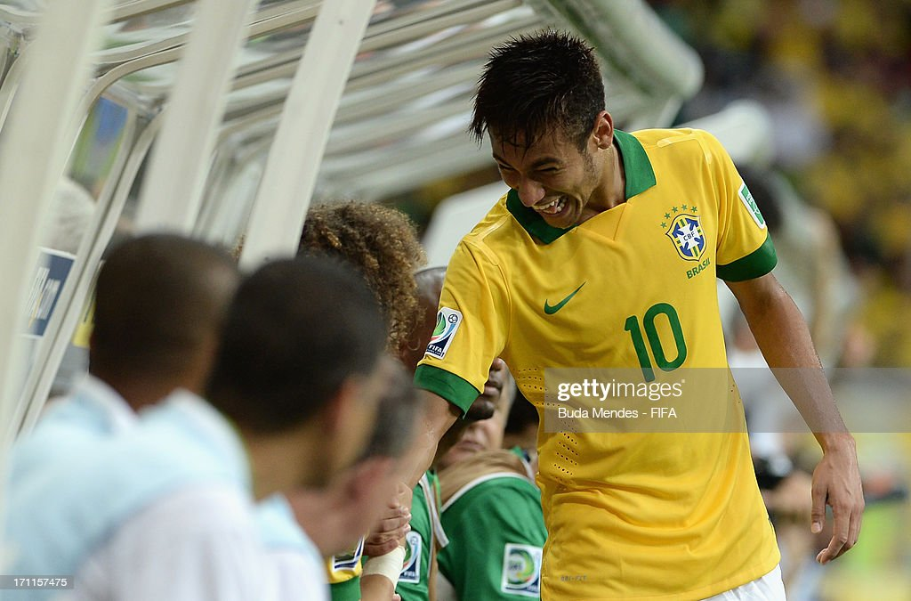 Neymar of Brazil (10) shakes hands with team mates as he is substituted during the FIFA Confederations Cup Brazil 2013 Group A match between Italy and Brazil at Estadio Octavio Mangabeira (Arena Fonte Nova Salvador) on June 22, 2013 in Salvador, Brazil.