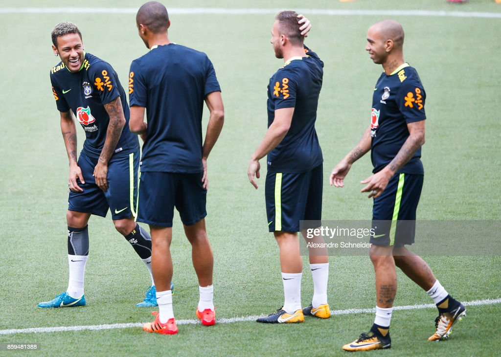 Neymar (L) of Brazil smiles during the Brazil training session for 2018 FIFA World Cup Russia Qualifier match against Chile at Allianz Parque Stadium on October 09, 2017 in Sao Paulo, Brazil.