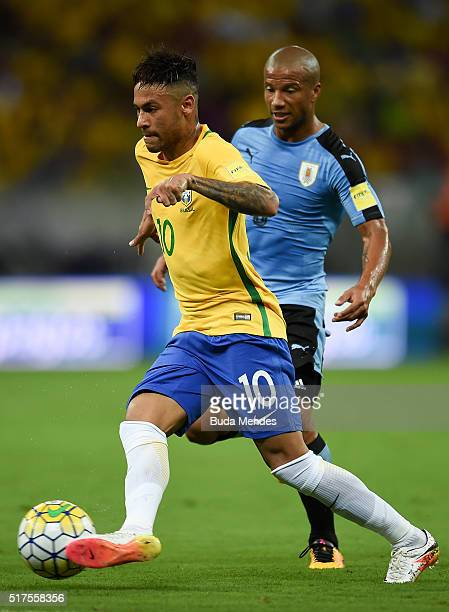 Neymar of Brazil struggles for the ball with Carlos Sanchez of Uruguay during a match between Brazil and Uruguay as part of 2018 FIFA World Cup...