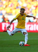 Neymar of Brazil takes a penalty kick during the shootout of the 2014 FIFA World Cup Brazil round of 16 match between Brazil and Chile at Estadio...