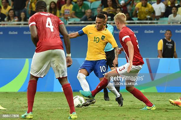 Neymar of Brazil vies for the ball with Kasper Larsen of Denmark during the Rio 2016 Olympic Games mens first round Group A football match Brazil vs...