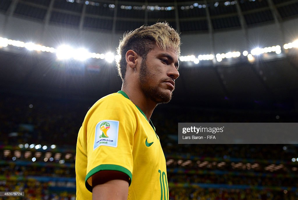 Neymar of Brazil walks off the pitch after the 2014 FIFA World Cup Brazil 3rd Place Playoff match between Brazil and Netherlands at Estadio Nacional on July 12, 2014 in Brasilia, Brazil.