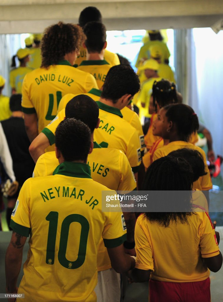 Neymar of Brazil walks through the tunnel prior to the FIFA Confederations Cup Brazil 2013 Group A match between Italy and Brazil at Estadio Octavio Mangabeira (Arena Fonte Nova Salvador) on June 22, 2013 in Salvador, Brazil.