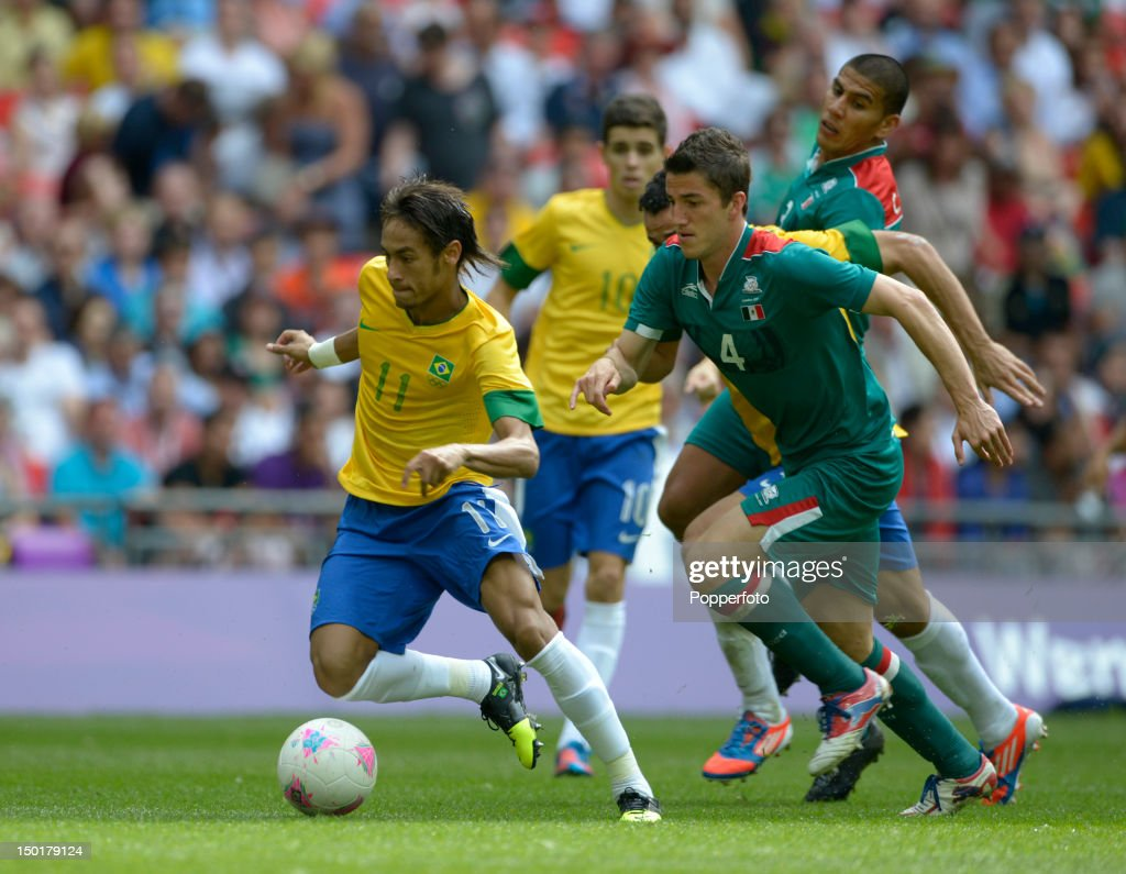 Neymar of Brazil with Hiram Mier of Mexico during the Men's Football Final between Brazil and Mexico on Day 15 of the London 2012 Olympic Games at Wembley Stadium on August 11, 2012 in London, England.