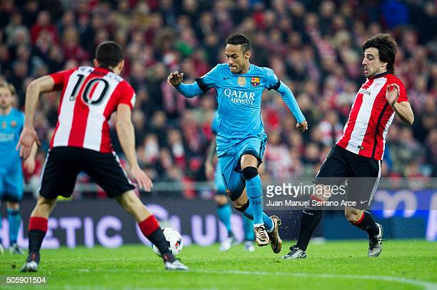 Neymar of FC Barcelola duels for the ball with Benat Etxebarria of Athletic Club during the Copa del Rey Quarter Final First Leg match between...