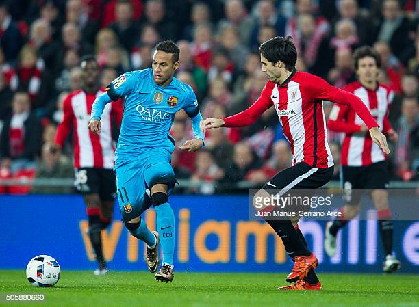 Neymar of FC Barcelola duels for the ball with Xabier Etxeita of Athletic Club during the Copa del Rey Quarter Final First Leg match between Athletic...