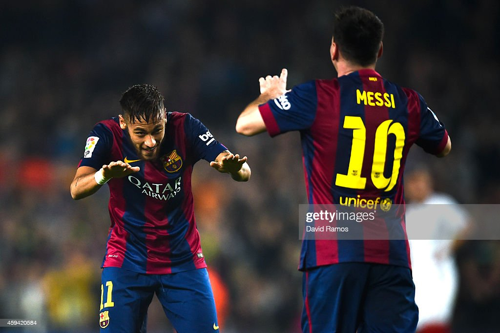 Neymar of FC Barcelona acknowledges to <a gi-track='captionPersonalityLinkClicked' href=/galleries/search?phrase=Lionel+Messi&family=editorial&specificpeople=453305 ng-click='$event.stopPropagation()'>Lionel Messi</a> of FC Barcelona after Messi scored his team's fourth goal during the La Liga match between FC Barcelona and Sevilla FC at Camp Nou on November 22, 2014 in Barcelona, Spain. <a gi-track='captionPersonalityLinkClicked' href=/galleries/search?phrase=Lionel+Messi&family=editorial&specificpeople=453305 ng-click='$event.stopPropagation()'>Lionel Messi</a> beat the record for number of goals in the Spanish La Liga by scoring his 252nd goal, the previous record of 251 was held by Telmo Zarra.
