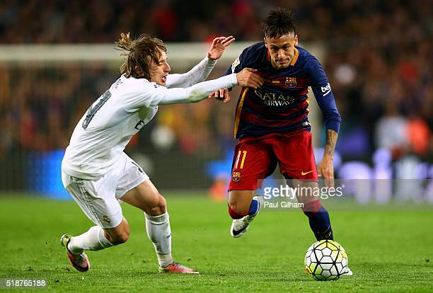 Neymar of FC Barcelona battles for the ball with Luka Modric of Real Madrid CF during the La Liga match between FC Barcelona and Real Madrid CF at...