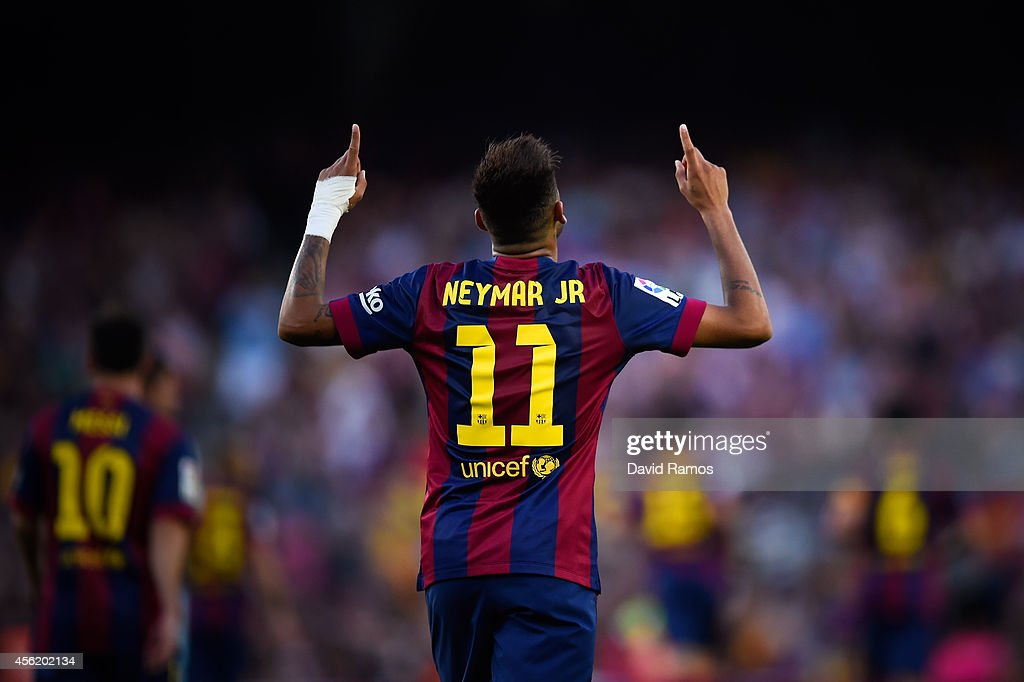 Neymar of FC Barcelona celebrates after scoring his team's fifth goal during the La Liga match between FC Barcelona and Granada CF at Camp Nou on September 27, 2014 in Barcelona, Spain.