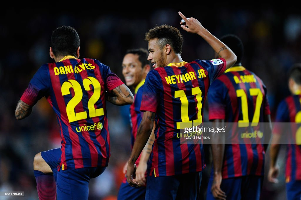 Neymar (C) of FC Barcelona celebrates after scoring his team's fourth goal during the La Liga match between FC Barcelona and Real Valladolid CF at Camp Nou on October 5, 2013 in Barcelona, Spain.