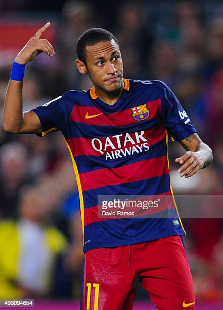 Neymar of FC Barcelona celebrates after scoring his team's second goal from the penalty spot during the La Liga match between FC Barcelona and Rayo...
