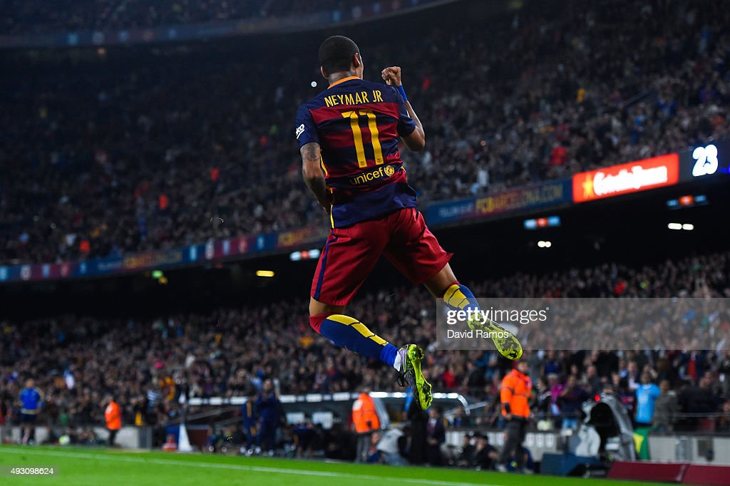Neymar of FC Barcelona celebrates after scoring his team's third goal during the La Liga match between FC Barcelona and Rayo Vallecano at the Camp Nou stadium on October 17, 2015 in Barcelona, Spain.