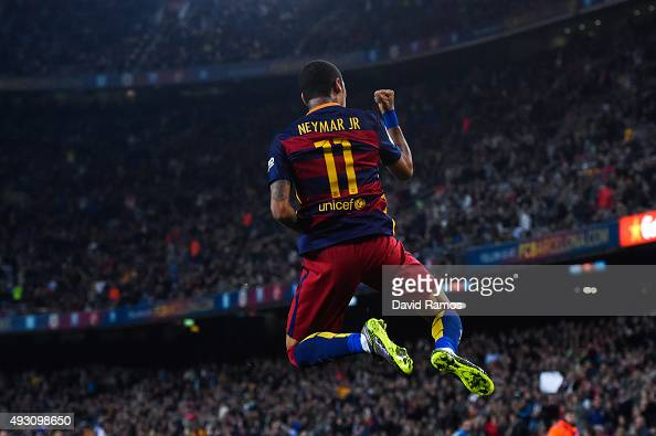 Neymar of FC Barcelona celebrates after scoring his team's third goal during the La Liga match between FC Barcelona and Rayo Vallecano at the Camp...