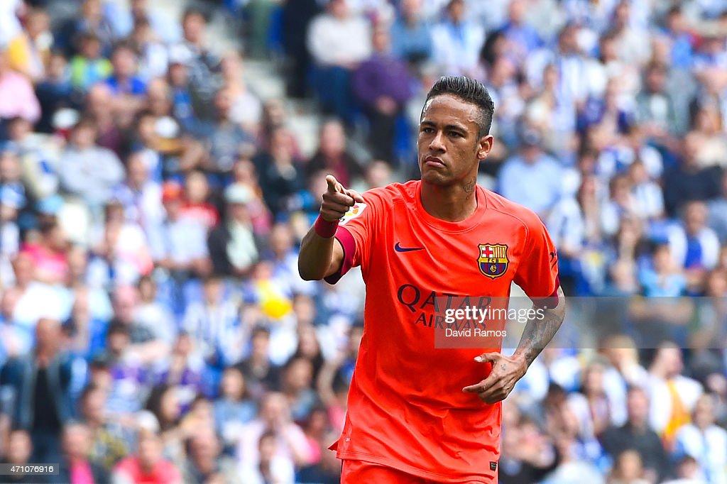 Neymar of FC Barcelona celebrates after scoring the opening goal during the La Liga match between RCD Espanyol and FC Barcelona at Cornella-El Prat Stadium on April 25, 2015 in Barcelona, Spain.