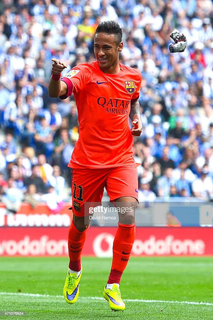 Neymar of FC Barcelona celebrates after scoring the opening goal during the La Liga match between RCD Espanyol and FC Barcelona at Cornella-El Prat Stadium on April 25, 2015 in Barcelona, Spain.