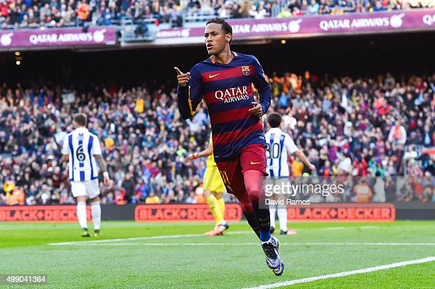 Neymar of FC Barcelona celebrates after scoring the opening goal during the La Liga match between FC Barcelona and Real Sociedad de Futbol at Camp...