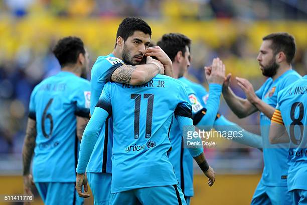 Neymar of FC Barcelona celebrates Luis Suarez after scoring his team's 2nd goal during the La Liga match between UD Las Palmas and FC Barcelona at...