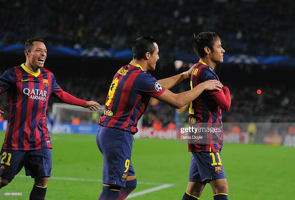 Neymar (R) of FC Barcelona celebrates with <a gi-track='captionPersonalityLinkClicked' href=/galleries/search?phrase=Alexis+Sanchez&family=editorial&specificpeople=5515162 ng-click='$event.stopPropagation()'>Alexis Sanchez</a> after scoring his team's 4th goal during the UEFA Champions League, Group H match between FC Barcelona and Celtic FC at the Camp Nou Stadium on December 11, 2013 in Barcelona, Spain.