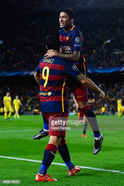 Neymar of FC Barcelona celebrates with his team mate Luis Suarez after scoring his team's third goalduring the UEFA Champions League Group E match...