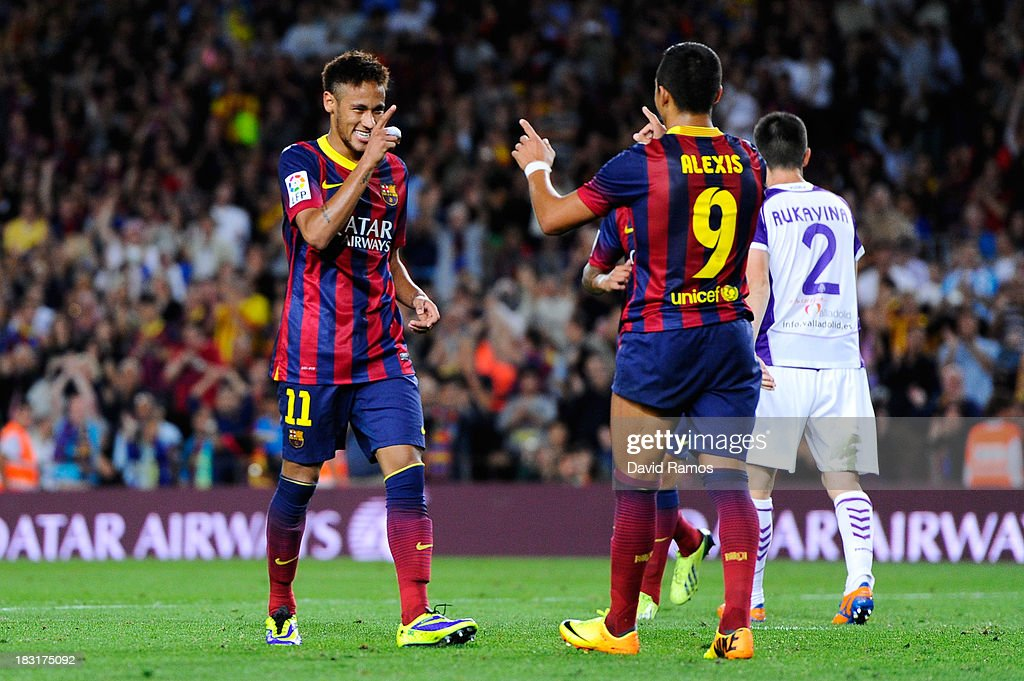 Neymar of FC Barcelona celebrates with his team-mate <a gi-track='captionPersonalityLinkClicked' href=/galleries/search?phrase=Alexis+Sanchez&family=editorial&specificpeople=5515162 ng-click='$event.stopPropagation()'>Alexis Sanchez</a> of FC Barcelona after scoring his team's fourth goal during the La Liga match between FC Barcelona and Real Valladolid CF at Camp Nou on October 5, 2013 in Barcelona, Spain.