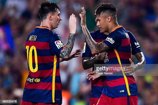 Neymar of FC Barcelona celebrates with his teammate Lionel Messi of FC Barcelona after scoring the opening goal during the Joan Gamper trophy match...