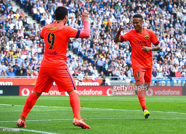 Neymar of FC Barcelona celebrates with his teammate Luis Suarez of FC Barcelona after scoring the opening goal during the La Liga match between RCD...