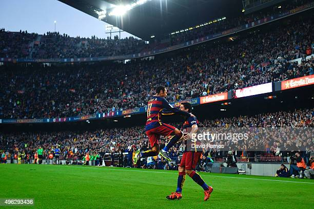 Neymar of FC Barcelona celebrates with his teammate Luis Suarez of FC Barcelona after scoring his team's third goal during the La Liga match between...