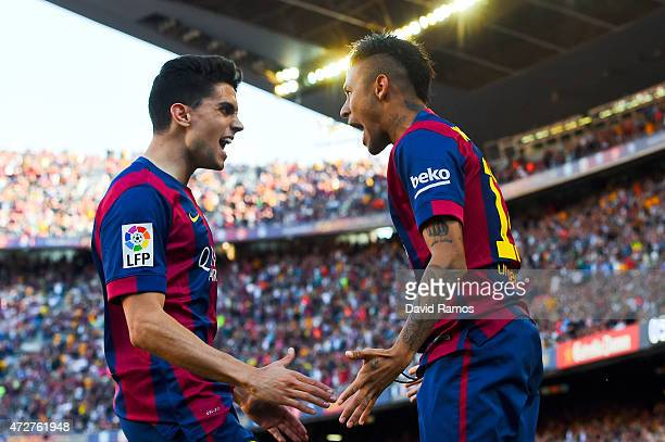 Neymar of FC Barcelona celebrates with his teammate Marc Bartra of FC Barcelona after scoring the opening goal during the La Liga match between FC...