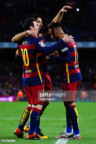 Neymar of FC Barcelona celebrates with his teammates Lionel Messi and Luis Suarez of FC Barcelona after scoring his team's sixth goal during the La...