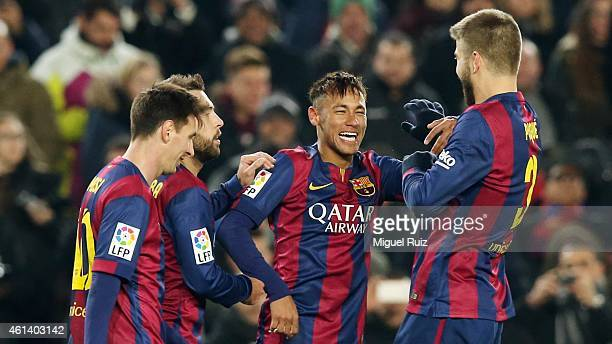 Neymar of FC Barcelona celebrates with his teammates Lionel Messi Jordi Alba and Gerard Pique as he scored the fifth goal during the Copa del Rey...